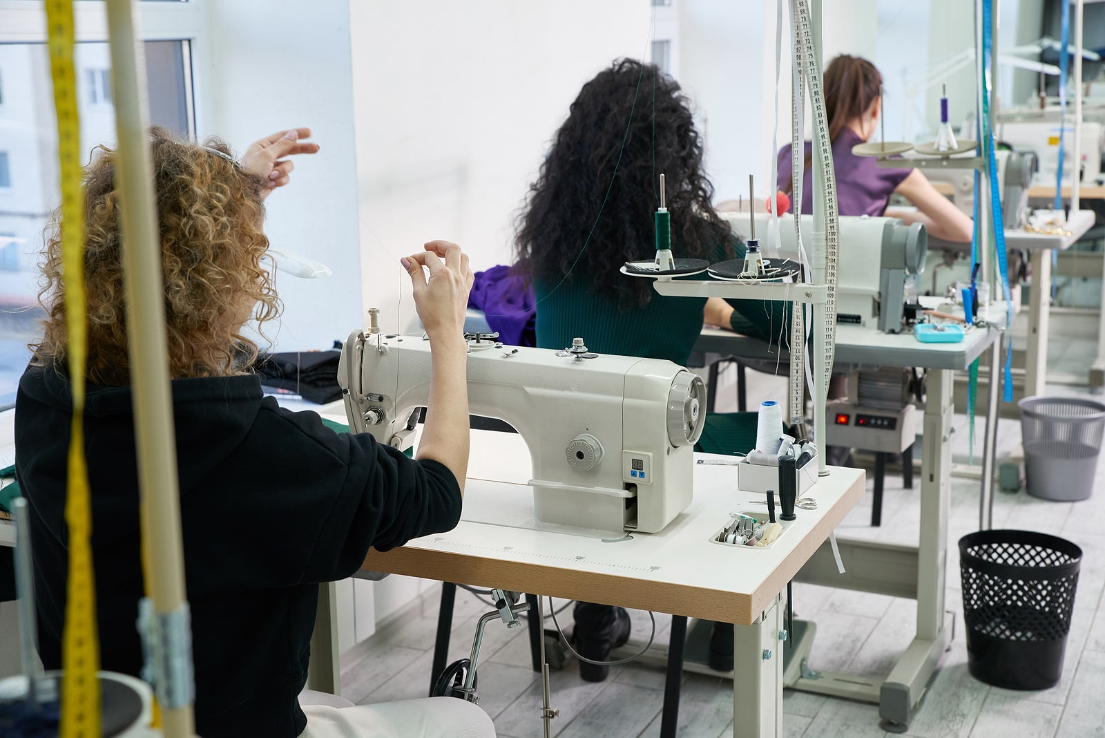bigstock-Young-Dressmaker-Women-Sew-Clo-347122285-min